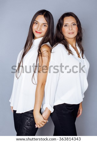 cute pretty teen daughter with mature mothr hugging, fashion style brunette - stock photo