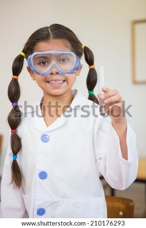 Cute pupil dressed up as scientist in classroom at the elementary school - stock photo