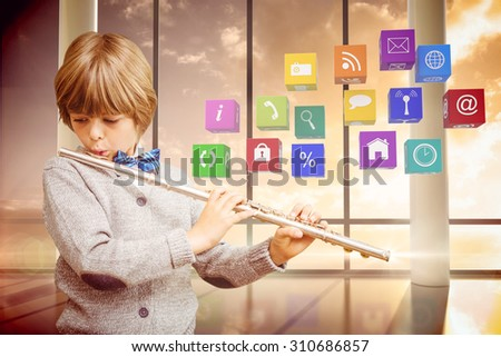 Cute pupil playing flute against room with large windows showing sunrise - stock photo