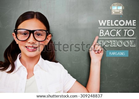 Cute pupil pointing against back to school - stock photo