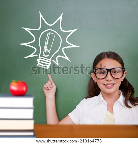 Cute pupil pointing against red apple on pile of books - stock photo