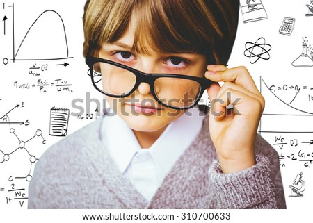 Cute pupil pretending to be teacher against math and science doodles - stock photo