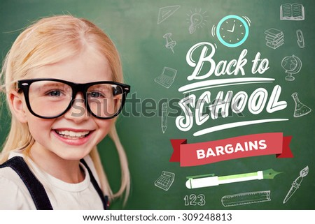Cute pupil smiling against back to school - stock photo
