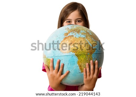 Cute pupil smiling holding globe on white background - stock photo