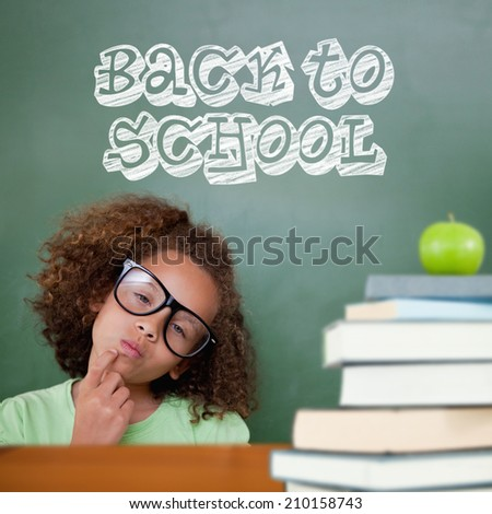 Cute pupil thinking against back to school message - stock photo