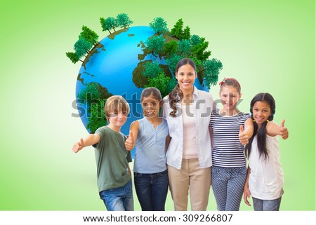Cute pupils and teacher smiling at camera in computer class against green vignette - stock photo
