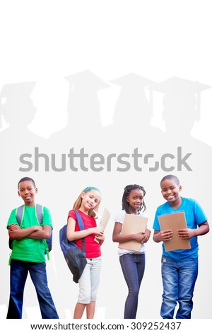 Cute pupils smiling at camera against silhouette of graduate - stock photo