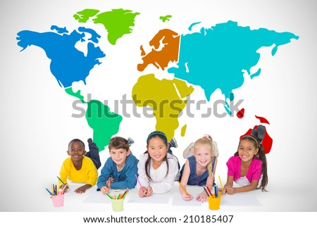 Cute pupils smiling at camera against white background with vignette with world map - stock photo