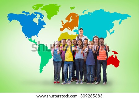 Cute pupils smiling at camera in the hall against green vignette - stock photo