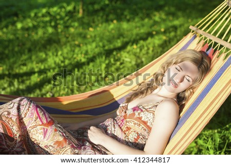 Cute Relaxing Caucasian Lady Resting in Hummock and Dreaming Outdoors.Horizontal  Shot - stock photo