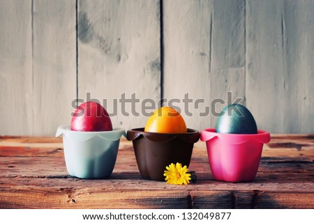 Cute retro photo with easter eggs in the nest - stock photo