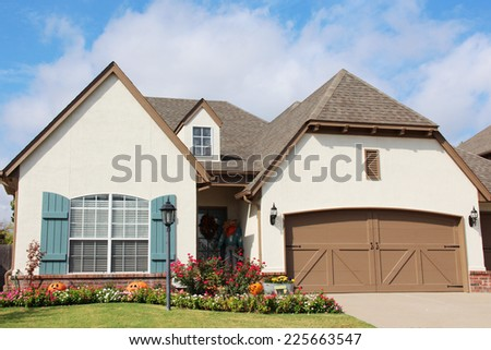 Cute rural house with lots of bushes and other greenery - stock photo
