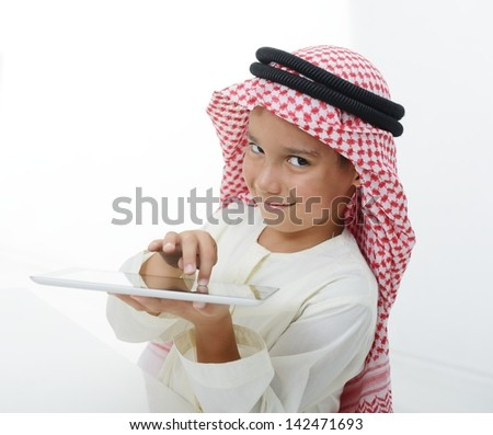 Cute Saudi Arabian kid with Tablet - stock photo