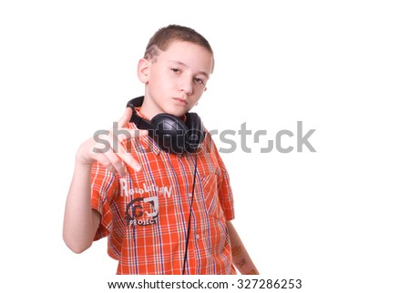 Cute schoolboy in orange shirt isolated over white - stock photo