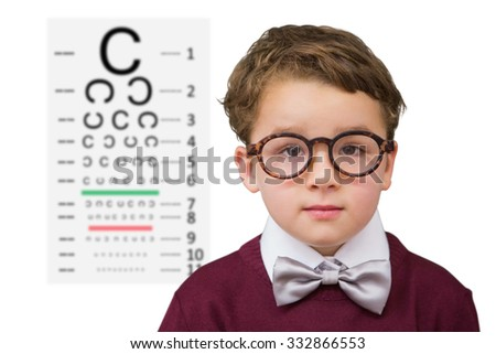 Cute schoolboy wearing reading glasses against eye test - stock photo