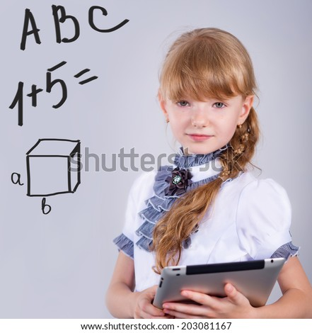 cute schoolgirl with a beautiful tablet - stock photo