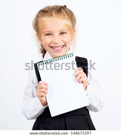 cute schoolgirl with a white sheet of notebook - stock photo