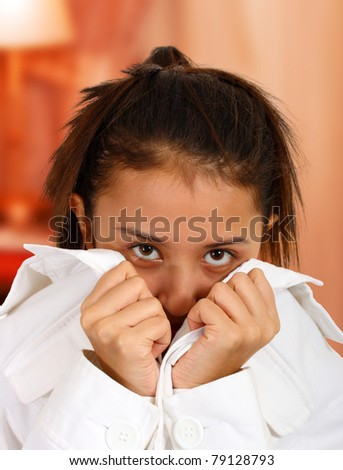 Cute shy girl in her bedroom - stock photo