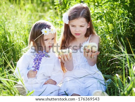 cute sisters outdoors - stock photo