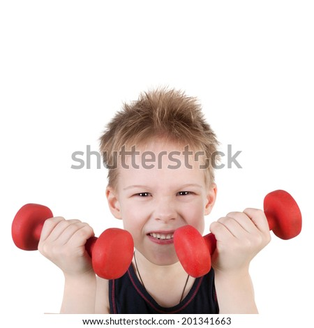 cute sly little boy training with the dumbbells - stock photo