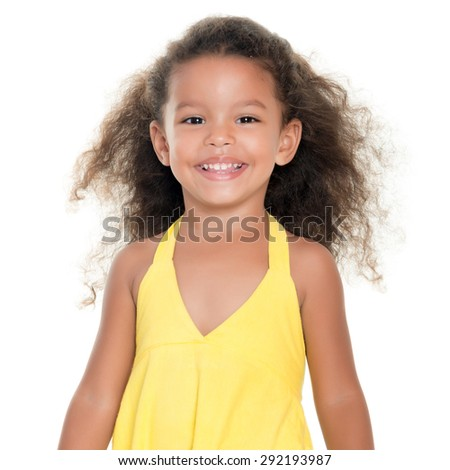 Cute small african-american or hispanic girl wearing a yellow summer dress isolated on white - stock photo