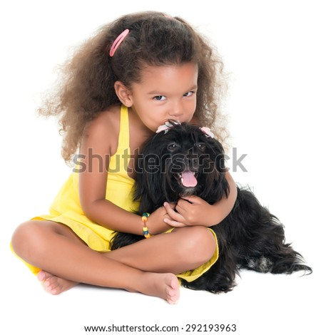 Cute small girl kissing her pet dog isolated on white - stock photo