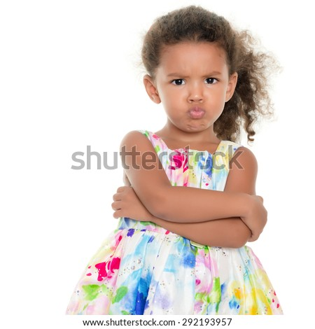 Cute small girl making a funny angry face isolated on white - stock photo