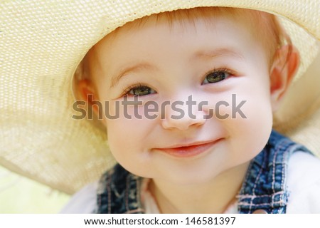 Cute smiling baby girl face close up outdoor in summer day - stock photo