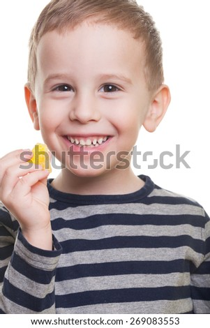 Cute smiling boy with jelly candy on isolated white - stock photo