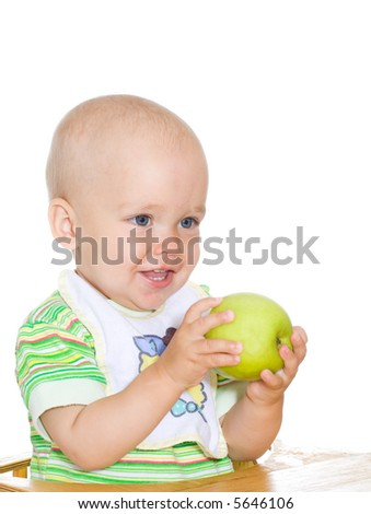 Cute smiling child holding green apple. Isolated. 2 - stock photo