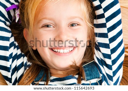 cute smiling girl looking at the camera - stock photo