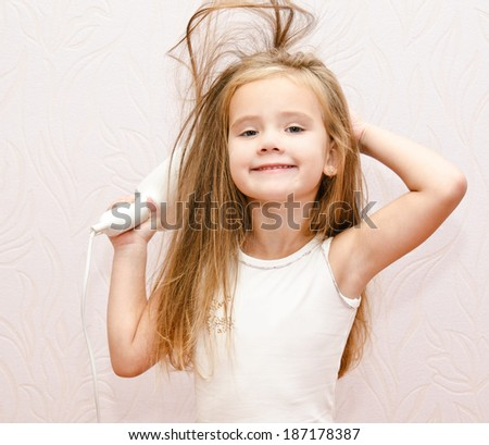 Cute smiling Little girl dries hair isolated - stock photo