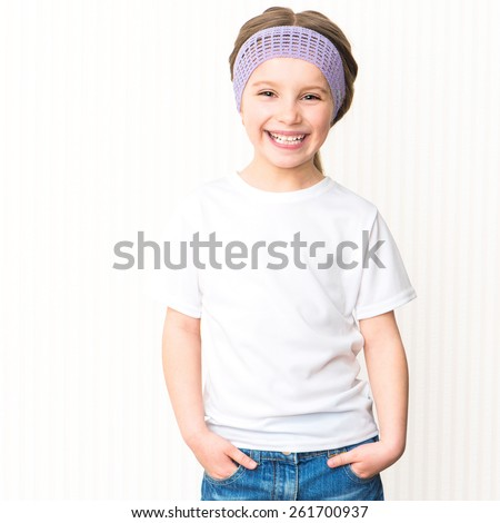 Cute smiling little girl in white t-shirt - stock photo