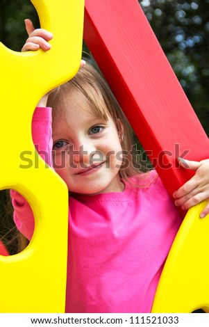 Cute smiling little girl  on playground posing. Portrait - stock photo