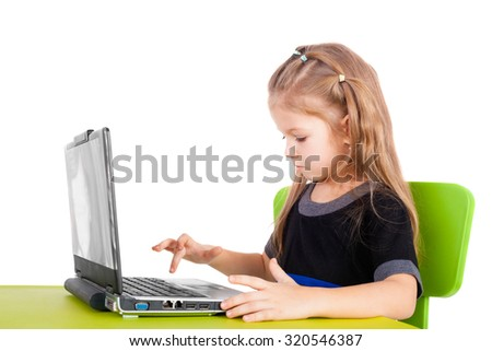 cute smiling little girl with computer - stock photo