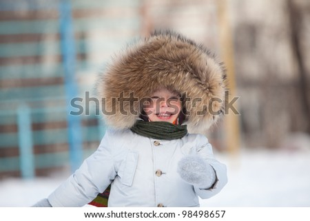 Cute smiling toddler in winter jacket - stock photo