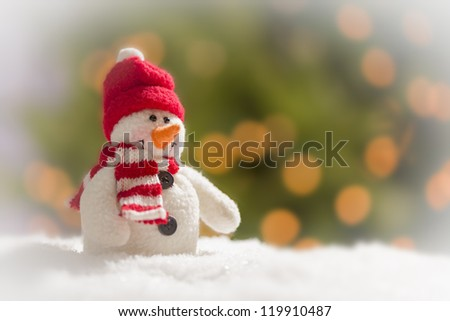 Cute Snowman Over Green and Gold Abstract Background. - stock photo