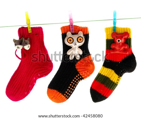Cute Socks Hanging on a Clothes Line Isolated on White - stock photo