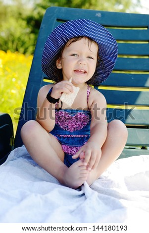 cute summer toddler on the sun lounger - stock photo