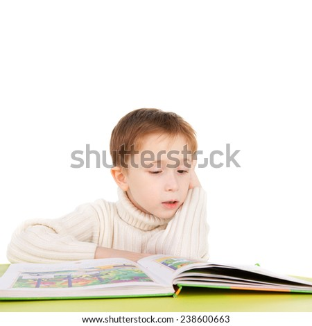 cute sweet boy reading a book - stock photo
