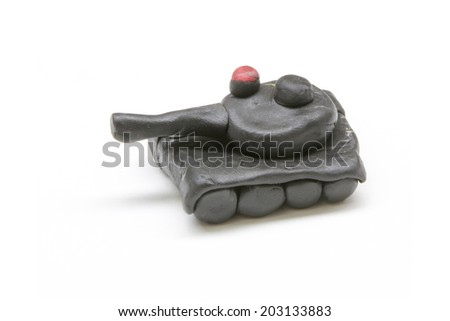 Cute tank made by clay sculpting on white background - stock photo