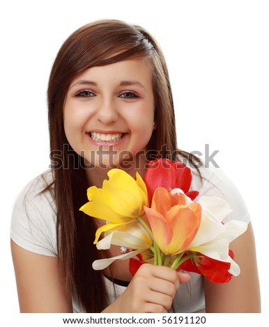 cute teen girl holding spring tulip  flower, white background - stock photo