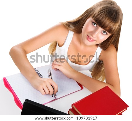 cute teen girl homeschooling with books and tablet isolated over white background - stock photo