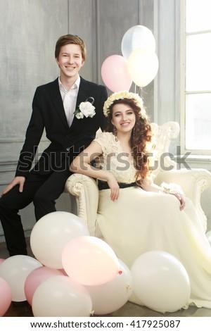 Cute Teenage Couple in beautiful interior - stock photo