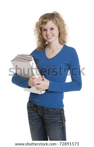 Cute teenage girl holding books on white background - stock photo