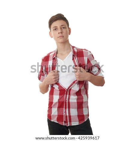Cute teenager boy acting like a super hero and tearing his red checkered shirt off over white isolated background, half body - stock photo