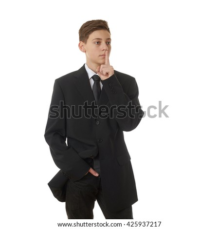 Cute teenager boy in back business suit with finger over mouth over white isolated background, half body, future career concept - stock photo