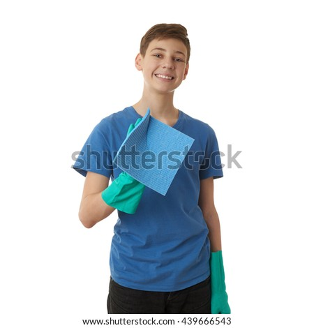 Cute teenager boy in blue T-shirt and green rubber gloves with rag over white isolated background, half body, cleaning concept - stock photo