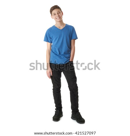 Cute teenager boy in blue T-shirt standing with hand in pocket over white isolated background full body - stock photo