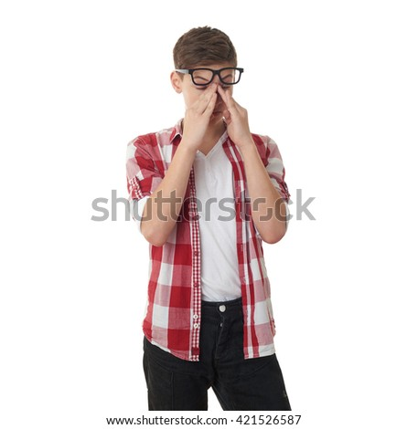 Cute teenager boy in red checkered shirt and glasses over white isolated background, half body - stock photo